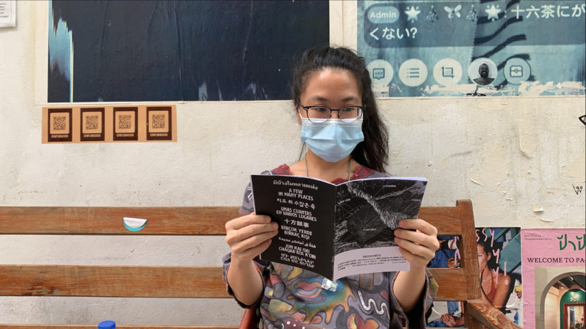 <p>Aracha Cholitgul is reading Protozine in Bangkok, photo credit: Abhijan Toto, 2021</p>